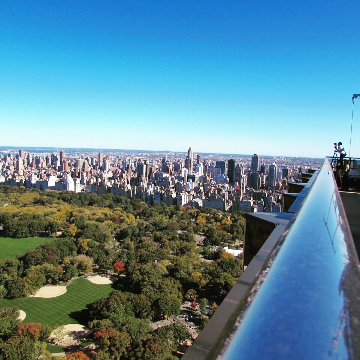 New York Art Director, Jessica Haas captures photographer Scott Frances shooting aerial views of Central Park from Trump New York Hotel